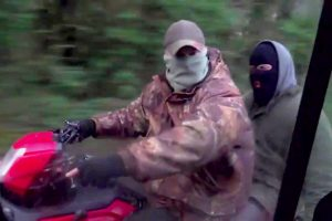 Masked pro-hunt gang on quad bikes chase protesters trying to protect foxes