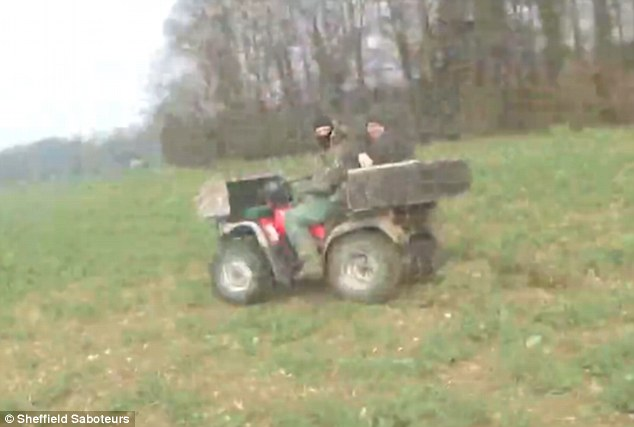 Threatening: One of the men on the quad bike appears to suggest his friend turns a gun on the saboteurs. There is no suggestion the Hunt is connected to the incident