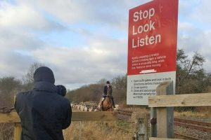 Grove and Rufford Hunt filmed with its hounds on a live rail line