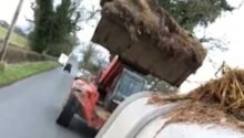 Meynell Hunt supporting farmer tips manure over sabs in van